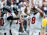 Matt Schaub leads the celebrations as the Texans beat Tennessee on September 15, 2013