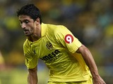 Jonathan Pereira of Villarreal runs with the ball during the La Liga match between Villarreal CF and Real Valladolid CF at El Madrigal Stadium on August 24, 2013