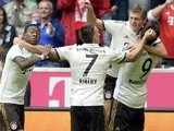 Mario Mandzukic is congratulated by Bayern players after a goal against Hannover on September 14, 2013