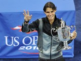Rafael Nadal holds the championship trophy after his win over Novak Djokovic during the men's final of the US Open on September 13, 2010