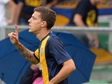Hellas Verona's Raphael Martinho celebrates after scoring the opening goal during the match against Sassuolo on September 15, 2013