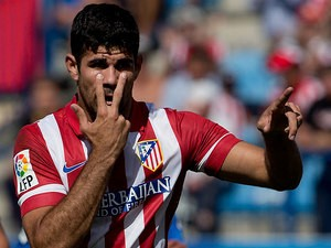 Atletico Madrid's Diego Costa celebrates after scoring his team's second goal against Almeria on September 14, 2013