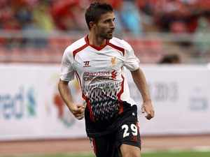Fabio Borini of Liverpool runs with the ball during the international friendly match between Thailand and Liverpool at the Rajamangala Stadium on July 28, 2013