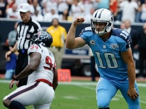 Titans QB Jake Locker celebrates a TD against Houston on September 15, 2013