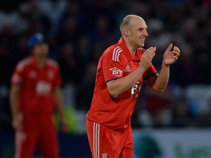 James Tredwell of England celebrates dismissing Ross Taylor of New Zealand during 3rd NatWest Series ODI match between England and New Zealand at Trent Bridge on June 5, 2013