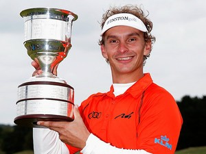 Joost Luiten celebrates with the trophy after winning the KLM Open on September 15, 2013
