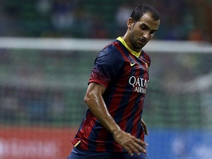 Barcelona's Martin Montoya in action against Malaysia XI during a friendly match on August 10, 2013