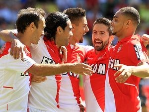 Monaco's Radamel Falcao is congratulated by team mates after scoring the opening goal from the penalty spot during the match against FC Lorient on September 15, 2013