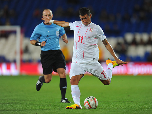 Serbia's Aleksandar Kolarov scores his team's second goal against Wales during their World Cup qualifier on September 10, 2013