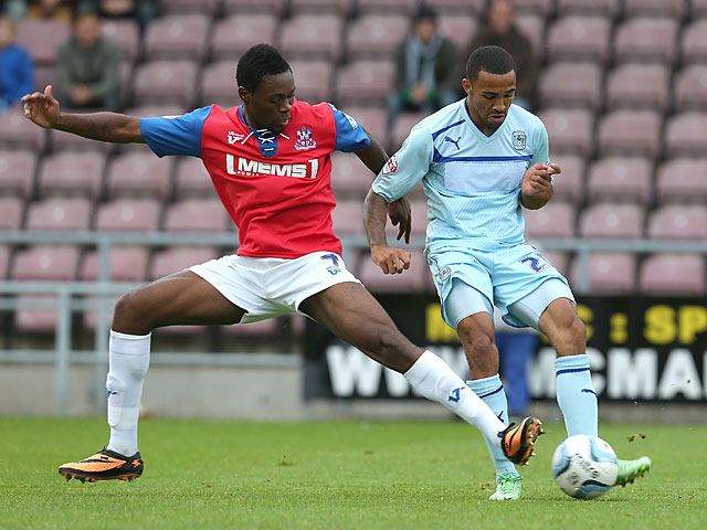 Gillingham's Amine Linganzi and Coventry's Callum Wilson in action during their League One match on September 15, 2013