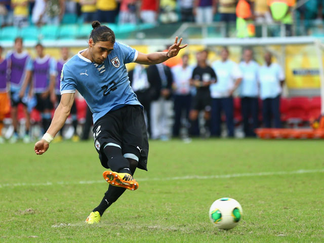 Martin Caceres of Uruguay miises a penalty kick duing a shootout during the FIFA Confederations Cup Brazil 2013 3rd Place match between Uruguay and Italy at Estadio Octavio Mangabeira (Arena Fonte Nova Salvador) on June 30, 2013