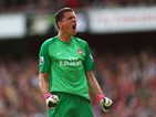 Wojciech Szczesny of Arsenal celebrates after Olivier Giroud of Arsenal scores their first goal during the Barclays Premier League match between Arsenal and Tottenham Hotspur at Emirates Stadium on September 01, 2013