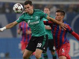 Schalke's Adam Szalai and Bucurestis Mihai Pintili battle for the ball during their Champions League group match on September 18, 2013