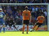 Wolves' Bakary Sako scores a penalty against Shrewsbury during their League One match on September 21, 2013