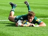Leicester Tigers' Blaine Scully dives in to score a try against Newcastle Falcons during their Aviva Premiership match on September 21, 2013