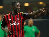 Milan's Cristian Zapata celebrates after scoring the opening goal against Celtic during their Champions League group match on September 18, 2013