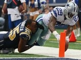 Cowboys' DeMarco Murray dives in a touchdown against St Louis on September 22, 2013