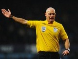 Referee Howard Webb signals for a free kick during the match between West Ham United and Queens Park Rangers at Upton Park on January 19, 2013