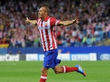 Atletico Madrid's Joao Miranda celebrates after scoring the opening goal against Zenit during their Champions League group match on September 18, 2013