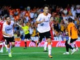 Valencia's Jonas Goncalves celebrates a goal against Sevilla on September 22, 2013