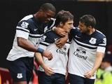 Everton's Leighton Baines is congratulated by teammates after scoring a free-kick against West Ham on September 21, 2013