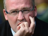 Aston Villa manager Paul Lambert watches his team during their Premier League match against Norwich on September 21, 2013