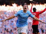 Manchester City's Samir Nasri celebrates after scoring his team's fourth goal against Manchester United during their Premier League match on September 22, 2013