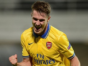 Arsenal's Aaron Ramsey celebrates after scoring his team's second goal against Marseille during their Champions League group match on September 18, 2013