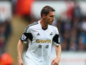Angel Rangel of Swansea City during the Barclays Premier League match between Swansea City and Manchester United at the Liberty Stadium on August 17, 2013