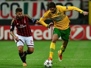 Milan's Antonio Nocerino and Celtic's Giorgios Samaras battle for the ball during their Champions League group match on September 18, 2013