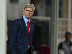 Arsenal manager Arsene Wenger on the touchline during his team's Champions League group match against Marseille on September 18, 2013