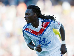 Lyon's Bafetimbi Gomis celebrates after scoring the opening goal against Nantes during their Ligue 1 match on September 22, 2013