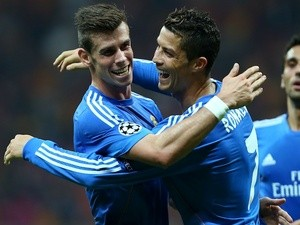 Cristiano Ronaldo and Gareth Bale celebrate one of the six goals Real Madrid scored against Galatasaray on September 17, 2013