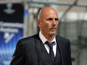 Marseille's French head coach Elie Baup leaves the pitch at the end of the UEFA Champions League group F football match Marseille vs. Arsenal on September 18, 2013