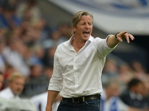 Schalke's head coach Jens Keller reacts during the German first division Bundesliga football match FC Schalke 04 vs Hamburger SV in the German city of Gelsenkirchen on August 11, 2013