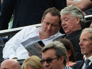 Newcastle chairman Mike Ashley speaks to director of football Joe Kinnear during the game with Hull on September 21, 2013