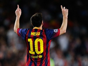 Barcelona's Lionel Messi celebrates after scoring the his team's second goal against Ajax during their Champions League group match on September 18, 2013