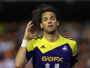 Swansea's Michu celebrates after scoring his team's second goal against Valencia during their Europa League group match on September 19, 2013