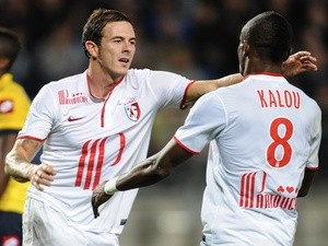 Lille's Nolan Roux celebrates a goal against Sochaux with Soloman Kalou on September 21, 2013