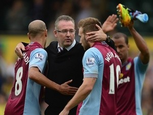 Aston Villa manager Paul Lambert congratulates his players following a 1-0 win over Norwich on September 21, 2013