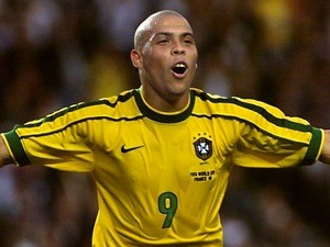 Brazil striker Ronaldo celebrates after scoring his second goal during the 1998 World Cup second round match between Brazil and Chile on June 27, 1998
