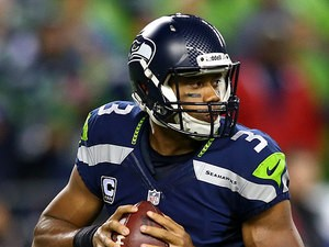 Seattle Seahawks' Russell Wilson in action against San Francisco 49ers on September 15, 2013