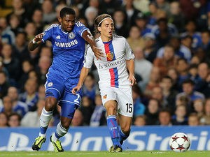 Chelsea's Samuel Eto'o and Basel's Kay Voser battle for the ball during their Champions League group match on September 18, 2013