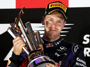 Sebastian Vettel lifts the trophy on the podium after winning the Singapore Formula One Grand Prix on September 22, 2013