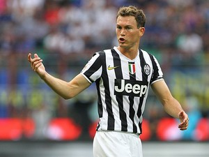 Juventus' Stephan Lichtsteiner in action against Inter during their Serie A match on September 14, 2013