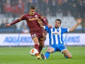 Zulte Waregem's Thorgan Hazard and Wigan's Jordi Gomez battle for the ball during their Europa League group match on September 19, 2013