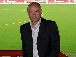 Uwe Rosler poses pitch-side as he is announced as the new manager of Brentford FC, at Griffin Park on June 16, 2011