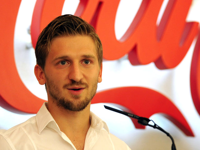Sevilla's new player German Marko Marin talks to the press during his official presentation in Sevilla, on July 4, 2013