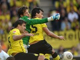 Braunschweig's goalkeeper Daniel Davari ,Dortmund's Greek defender Sokratis and Dortmund's defender Mats Hummels vie for the ball during the German first division Bundesliga football match Borussia Dortmund vs Eintracht Braunschweig in Dortmund, western G