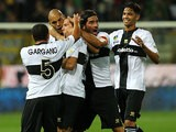 Parma's Djamel Mesbah is congratulated by teammates after scoring the opening goal against Atalanta during their Serie A match on September 25, 2013
